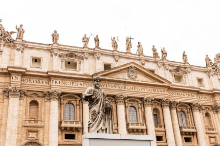 Photo for ROME, ITALY - JUNE 28, 2019: exterior of basilica of saint peter under grey sky - Royalty Free Image