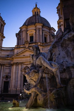 Photo for ROME, ITALY - JUNE 28, 2019: fountain with ancient roman statues near old building under sky - Royalty Free Image