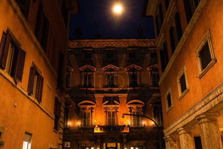 buildings with illumination at night in rome, italy