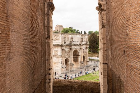 Photo for ROME, ITALY - JUNE 28, 2019: group of tourists near near arch of Constantine under overcast sky - Royalty Free Image