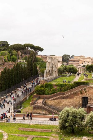 ROME, ITALY - JUNE 28, 2019: crowd of tourists walking at roman forum