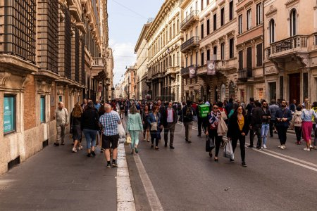Photo for ROME, ITALY - JUNE 28, 2019: crowd of people walking on street near old buildings - Royalty Free Image