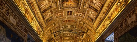 ROME, ITALY - JUNE 28, 2019: panoramic shot of golden ceiling with frescoes