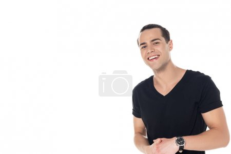 Foto de Handsome brunette young man in black t-shirt smiling and looking at camera isolated on white - Imagen libre de derechos