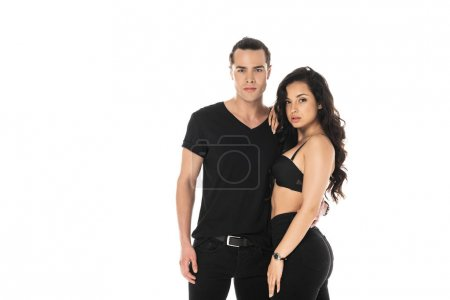 Photo for Couple in black clothes embracing and looking at camera isolated on white - Royalty Free Image