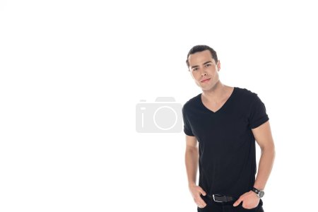 Foto de Handsome young man in black clothes with hands in pockets looking at camera isolated on white - Imagen libre de derechos