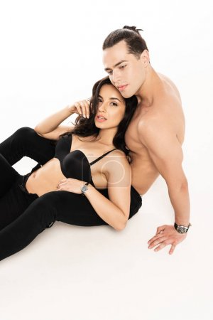 Photo for Sexy young couple in black clothes on white - Royalty Free Image