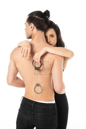 sexy couple with handcuffs embracing isolated on white