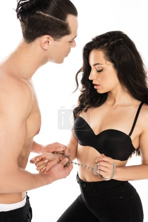 Photo for Sexy young couple with handcuffs isolated on white - Royalty Free Image