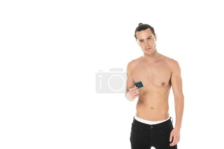 Photo for Front view of sexy shirtless man holding condom and looking at camera isolated on white - Royalty Free Image