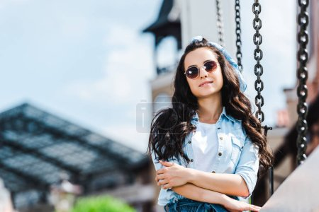 Photo for Selective focus of beautiful woman in sunglasses smiling while looking at camera - Royalty Free Image