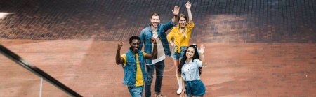 Photo for Panoramic shot of happy multicultural friends gesturing while standing together - Royalty Free Image