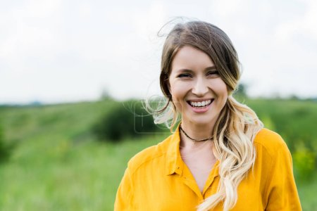 positive young woman smiling while looking at camera