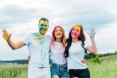 """Постер, картина, фотообои """"happy group of friends with holi paints on faces smiling outdoors """""""