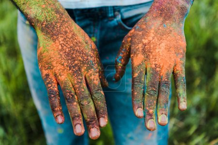 Photo for Cropped view of african american man with colorful holi paints on hands - Royalty Free Image