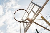 "Постер, картина, фотообои ""bottom view of basketball backboard under blue sky with clouds in sunny day"""