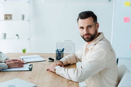 Photo for Cropped view of recruiter near handsome bearded man looking at camera - Royalty Free Image
