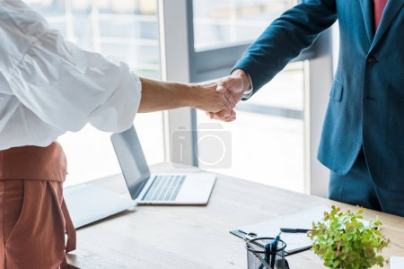 Photo for Cropped view of employee and recruiter shaking hands in office - Royalty Free Image