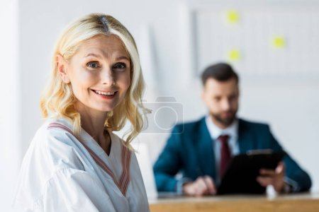 Photo for Selective focus of happy blonde employee near recruiter - Royalty Free Image