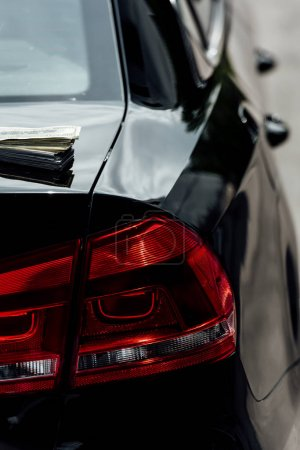 Photo for Close up view of black car headlight and cash on wallet - Royalty Free Image