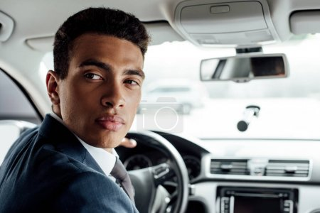 Photo for African american businessman in suit driving car - Royalty Free Image