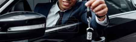 Photo for Cropped view of smiling african american businessman holding car key, panoramic shot - Royalty Free Image