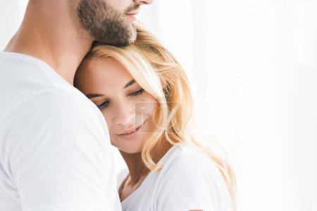 Photo for Beautiful blonde woman leaning on bearded man with copy space - Royalty Free Image