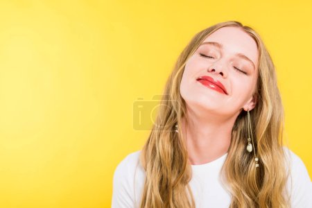 Photo for Beautiful blonde young woman with eyes closed Isolated On yellow - Royalty Free Image