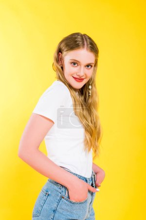 Photo for Beautiful blonde young woman with Hands In Pockets posing Isolated On yellow - Royalty Free Image
