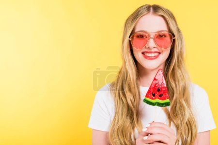 Photo for Beautiful smiling girl with lollipop in shape of watermelon On yellow - Royalty Free Image