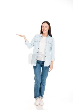 Photo for Full length view of happy brunette woman pointing with hand isolated on white - Royalty Free Image