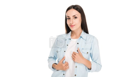 Photo for Smiling brunette woman with hands on denim jacket isolated on white - Royalty Free Image