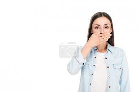 brunette woman covering mouth with hand isolated on white