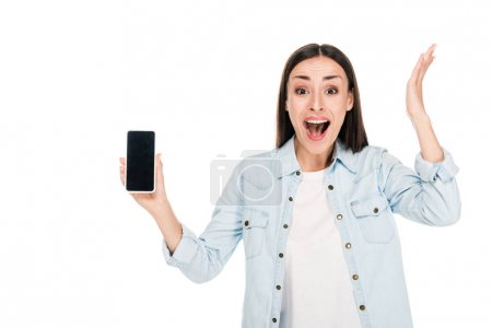 excited young woman showing smartphone with blank screen isolated on white