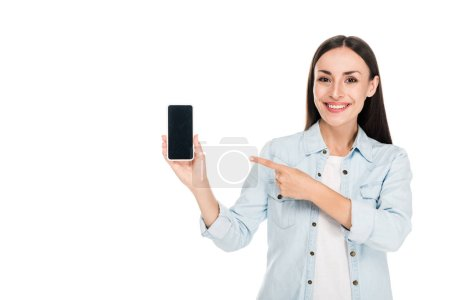 Photo for Excited young woman pointing with finger at smartphone with blank screen isolated on white - Royalty Free Image