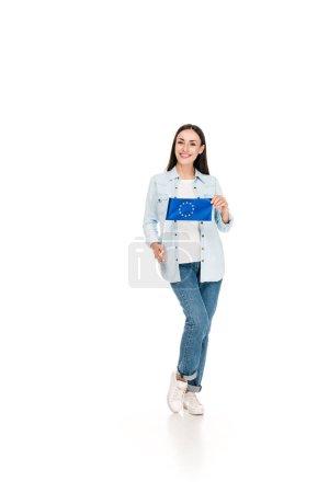 smiling girl in denim jacket holding flag of Europe isolated on white