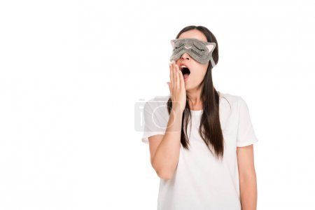 Photo for Brunette young woman in cat sleeping eye mask yawning isolated on white - Royalty Free Image