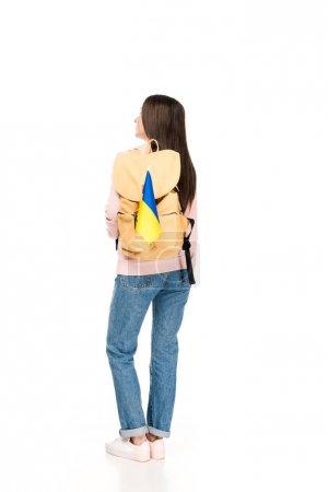 Photo pour Vue arrière de l'étudiant avec le sac à dos et le drapeau ukrainien d'isolement sur le blanc - image libre de droit