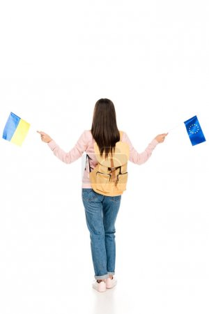 Photo for Full length view of student with backpack holding Ukrainian and European flags isolated on white - Royalty Free Image