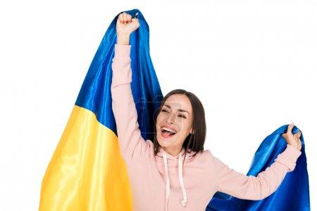 Photo pour Jeune fille heureuse retenant le drapeau de satin de l'Ukraine et se réjouissant isolé sur le blanc - image libre de droit