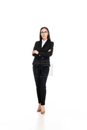 Photo for Confident businesswoman in black suit with crossed arms isolated on white - Royalty Free Image