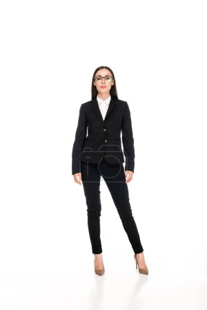 Photo for Full length view of confident businesswoman in black suit with crossed arms isolated on white - Royalty Free Image