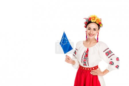 Photo for Happy brunette young woman in national Ukrainian costume holding European flag isolated on white - Royalty Free Image