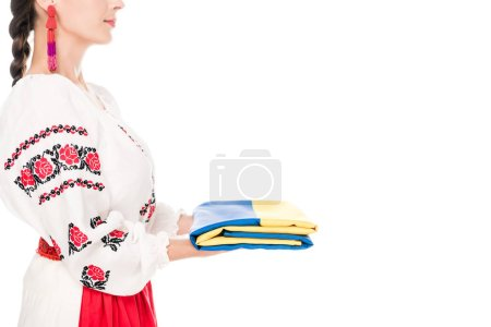Photo for Cropped view of young woman in national Ukrainian costume holding flag isolated on white - Royalty Free Image