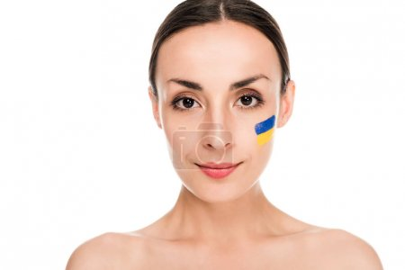 Photo pour Naked young woman with painted Ukrainian flag on face isolated on white - image libre de droit