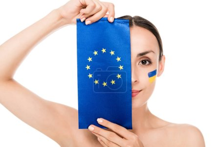 Photo for Naked young woman with painted Ukrainian flag on face holding flag of Europe isolated on white - Royalty Free Image