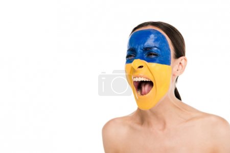 Photo pour Naked young woman with painted Ukrainian flag on skin screaming isolated on white - image libre de droit
