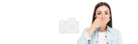 Photo for Brunette woman covering mouth with hand isolated on white, panoramic shot - Royalty Free Image