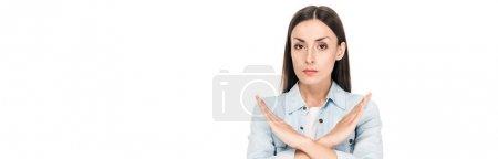 Foto de Brunette woman showing no sign isolated on white, panoramic shot - Imagen libre de derechos
