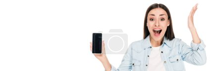 Photo for Excited young woman showing smartphone with blank screen isolated on white, panoramic shot - Royalty Free Image